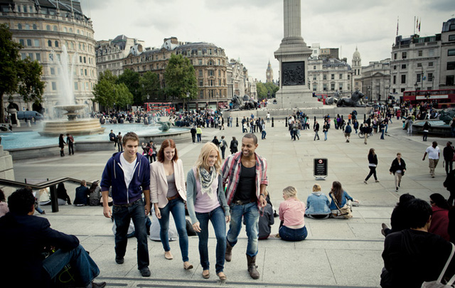 Visitors enjoy Trafalgar Square and surrounding area