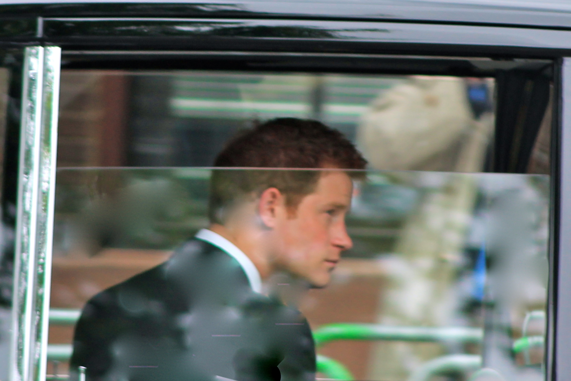 Prince Harry driving through the City of London during the Diamond Jubilee celebrations, 5 June 2012. By Carfax2, licensed under the Creative Commons Attribution-Share Alike 3.0 Unported license.